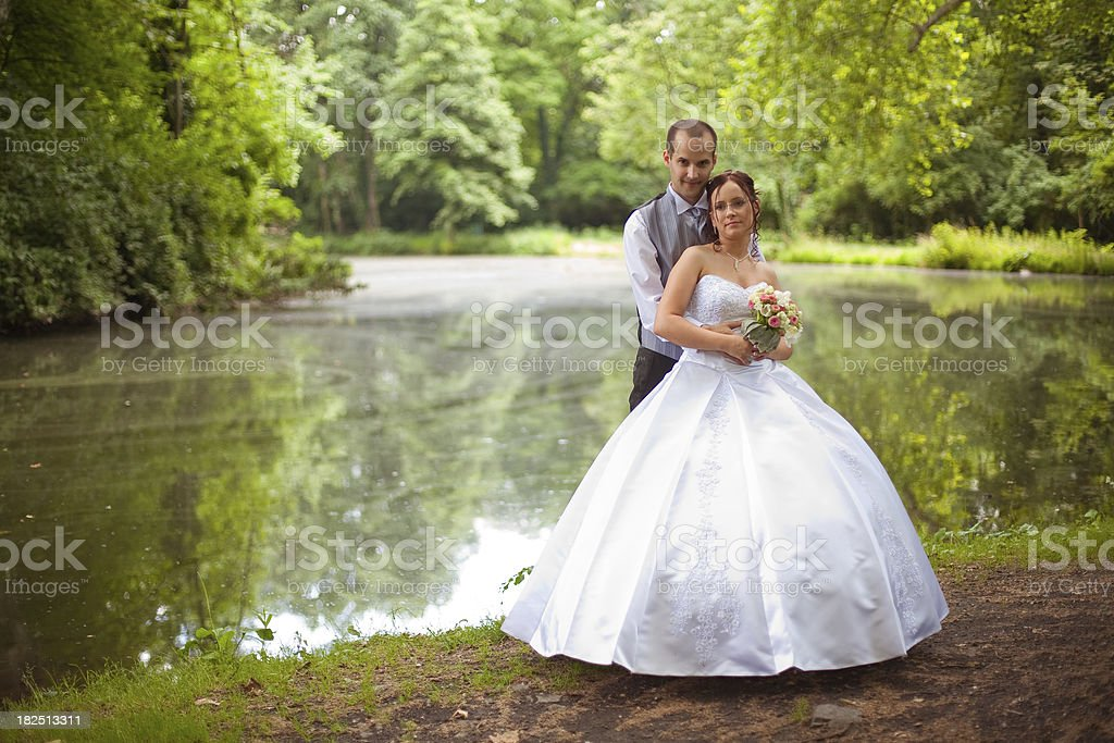 just married couple by the lake royalty-free stock photo