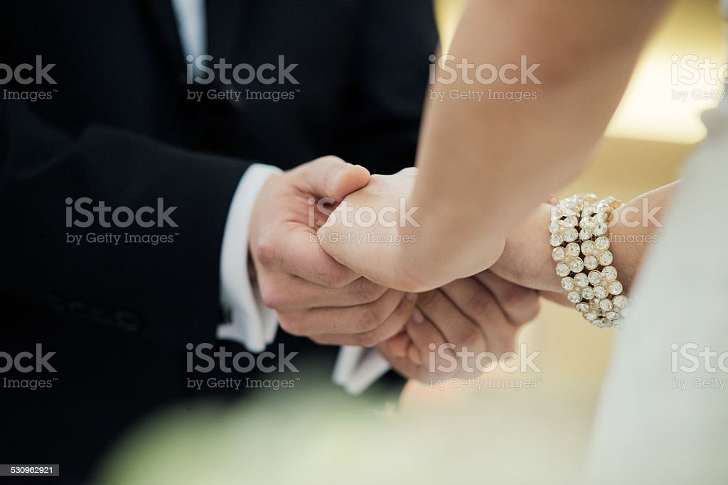 Christian Married Couple Holding Hands