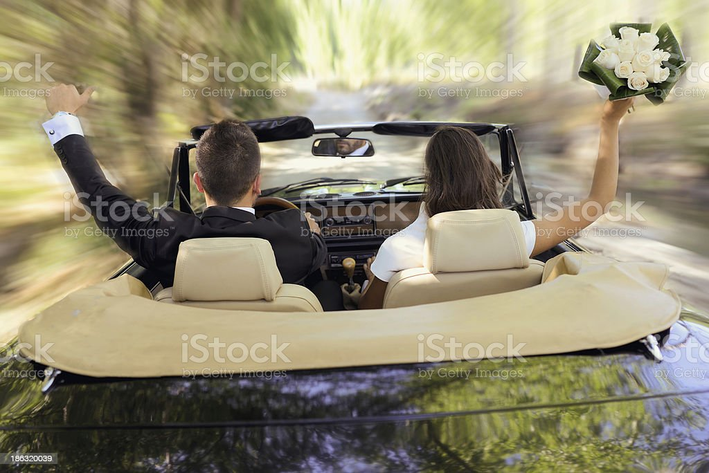 Just married couple in an old convertible car stock photo