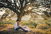 Just married couple under a beautiful tree