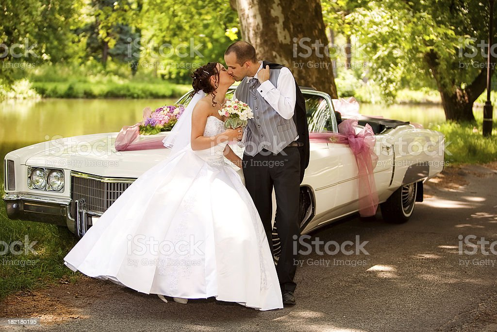 just married couple with car by the lake royalty-free stock photo