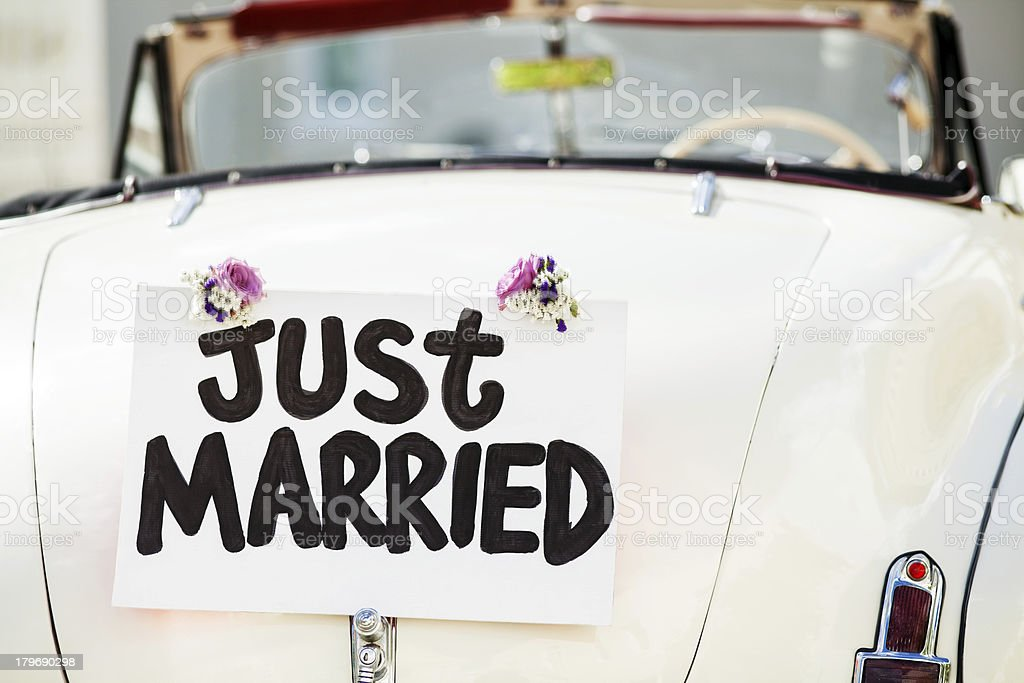 Just Married Sign Attached On Convertible Car's Trunk stock photo