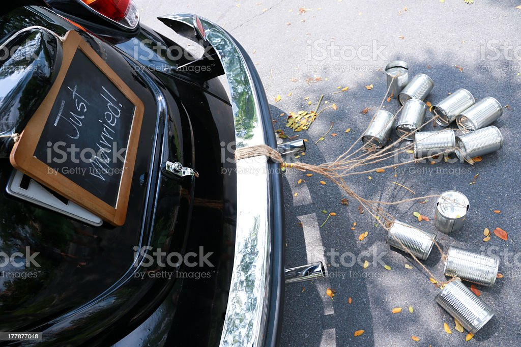 Just married sign on a car with cans tied to the rear bumper stock photo