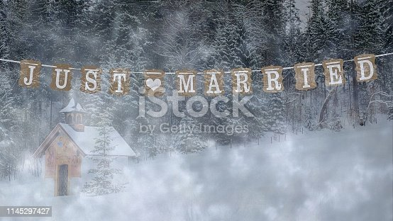 istock Just married text on small winter chapel  background 1145297427
