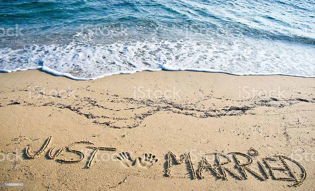 Just Married written in the Sand stock photo