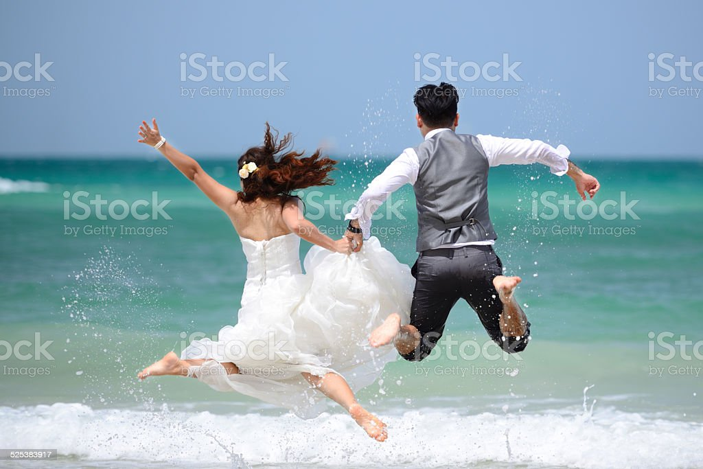 just married young couple celebrating and have fun stock photo