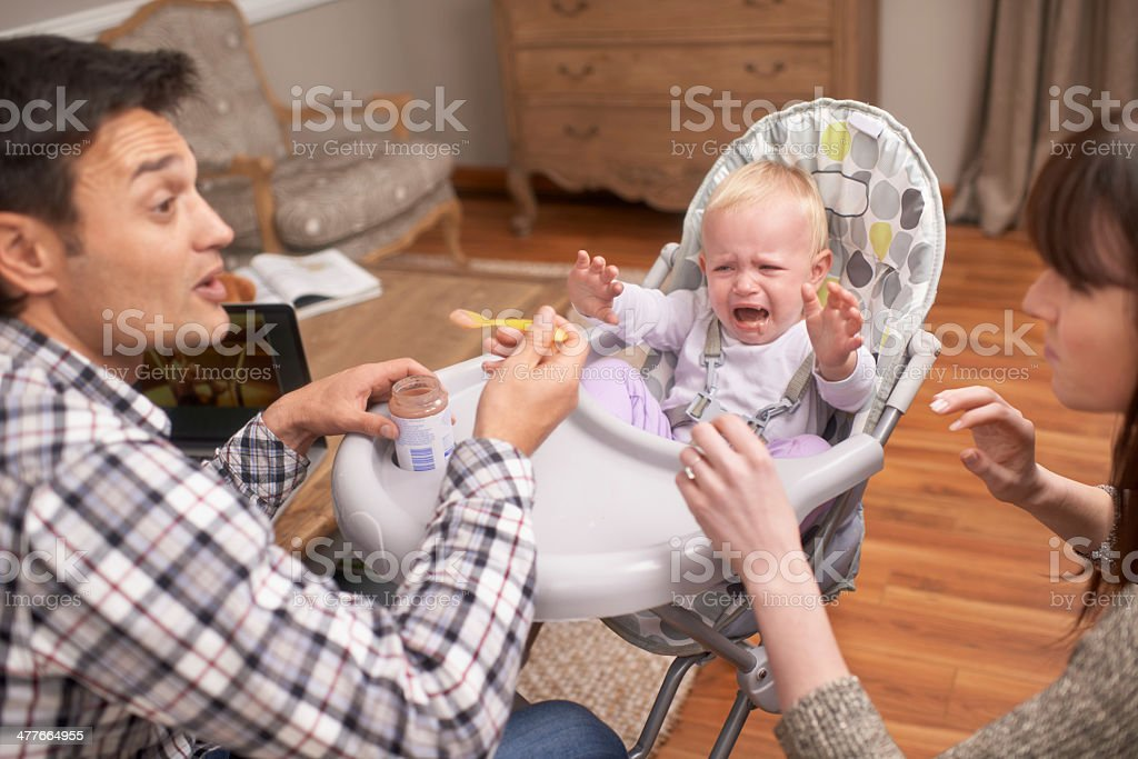 Just one more bite, my little angel! stock photo