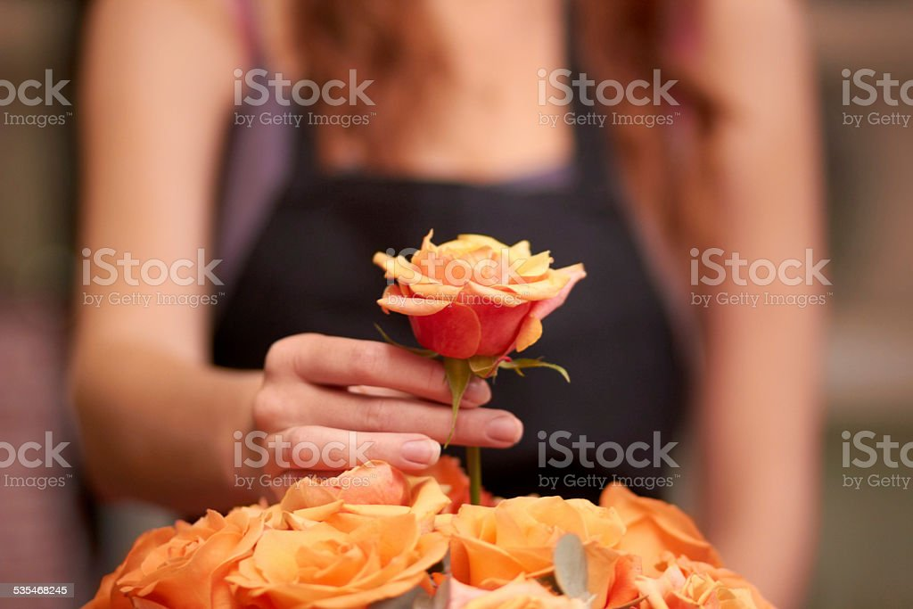 Just one more rose should do it stock photo