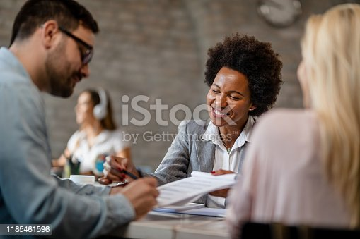 944314580 istock photo Just one more signature and we are done! 1185461596