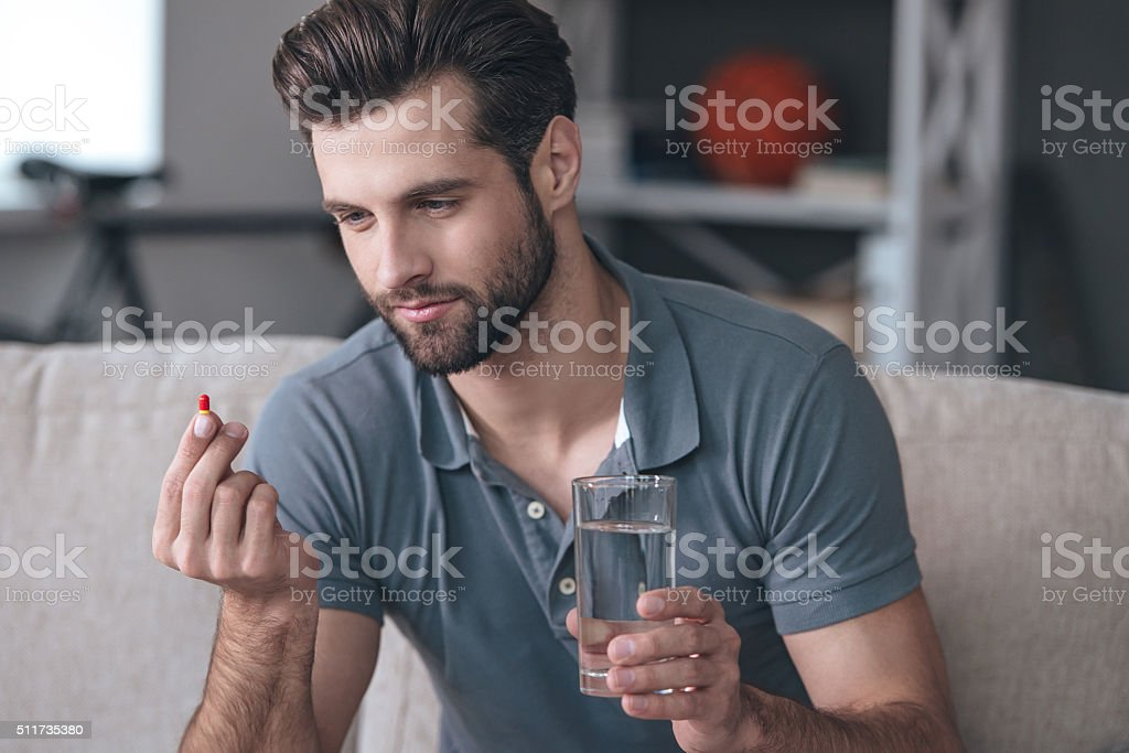 Just one pill can help. stock photo