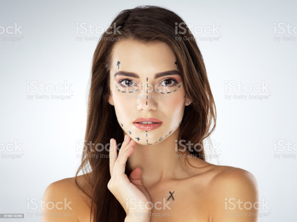 Just perfecting her imperfections stock photo