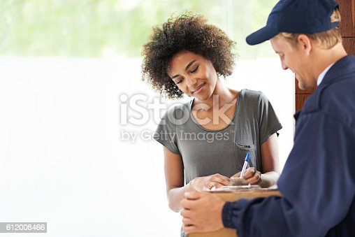 1053001624 istock photo Just sign here and it's all yours 612008466