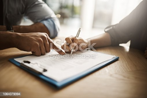 istock Just sign here 1064079394