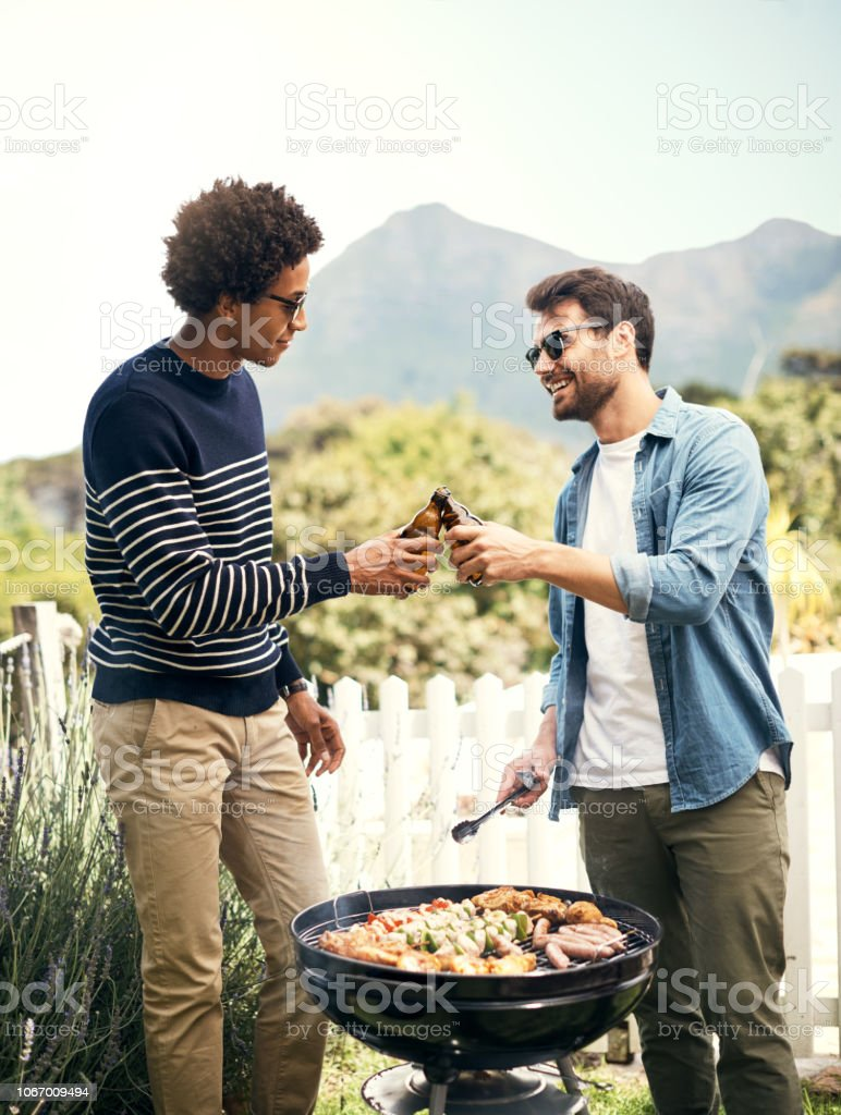 Just two bros cracking a cold one stock photo