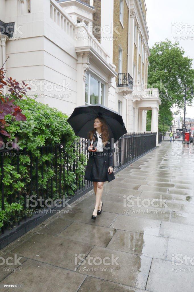 Just walking in the rain Russian outdoor girl stock photo