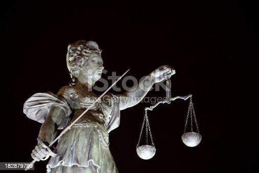 Justice sculpture at night