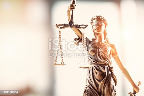 istock Justice blindfolded lady holding scales and sword statue 908570654