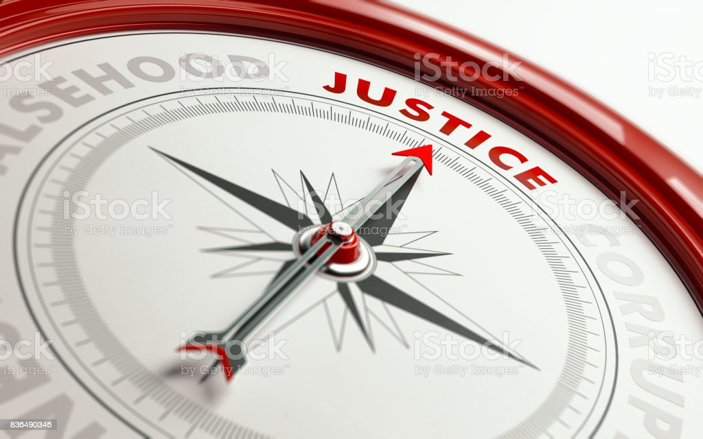 Justice Concept: Arrow of A Compass Pointing Justice Text stock photo