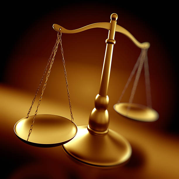 Justice concept - scales with depth of field stock photo