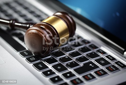 istock Justice gavel and laptop computer keyboard 524816639