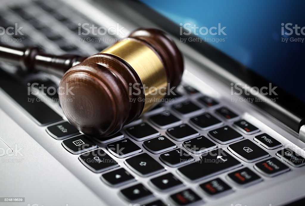 Justice gavel and laptop computer keyboard stock photo