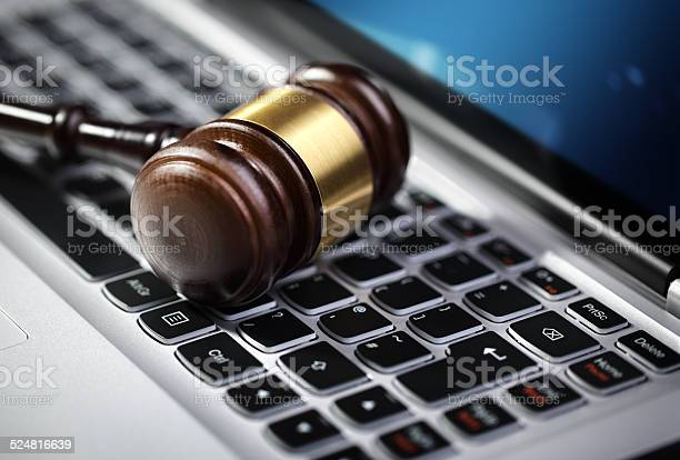 Justice Gavel And Laptop Computer Keyboard Stock Photo - Download Image Now