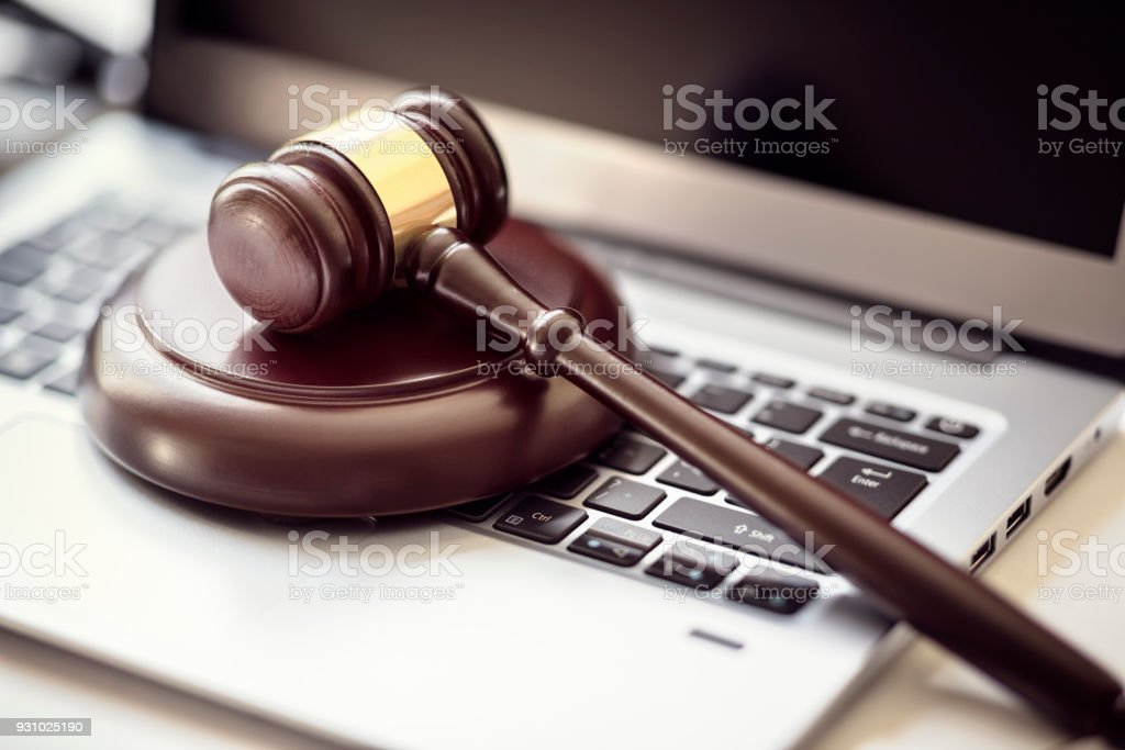Justice gavel on laptop computer keyboard stock photo