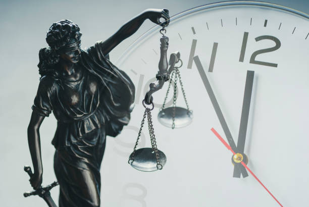 Justice holding the scales of justice and law stock photo