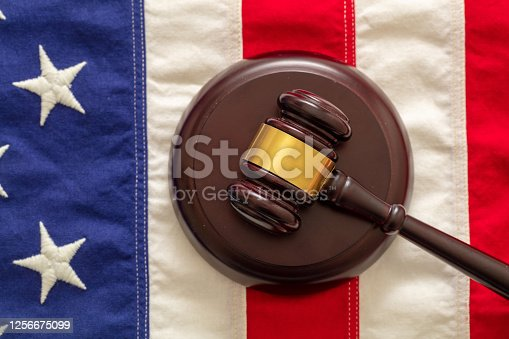 Judge or auction gavel on United states of America flag background. Justice and law in USA concept. Vertical, top view