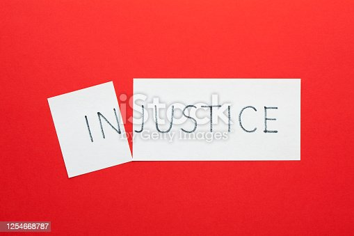 Changing the word injustice to justice on a white sheet
