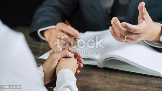 istock Justice lawyer consulting give a advice with client in courtroom. 1157974190