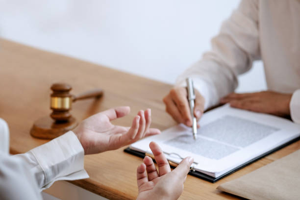 Justice lawyer consulting give a advice with client in courtroom. stock photo