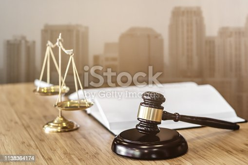 istock Justice or Real Estate Auction Concept, Judge's Gavel of lawyer in courtroom. 1138364174