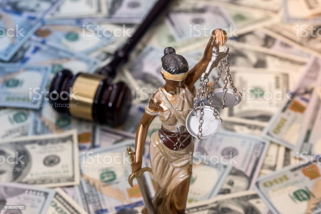 Justice Scale and wooden hammer on dollar bills Justice Scale and wooden hammer on dollar bills Auction Stock Photo