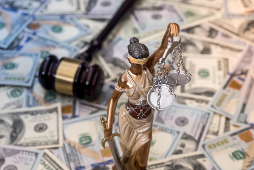 Justice Scale And Wooden Hammer On Dollar Bills Stock Photo - Download Image Now