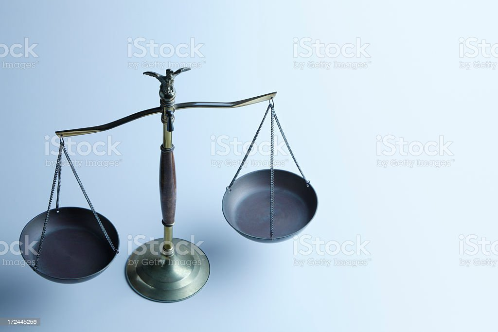 Justice scale on a light blue background royalty-free stock photo