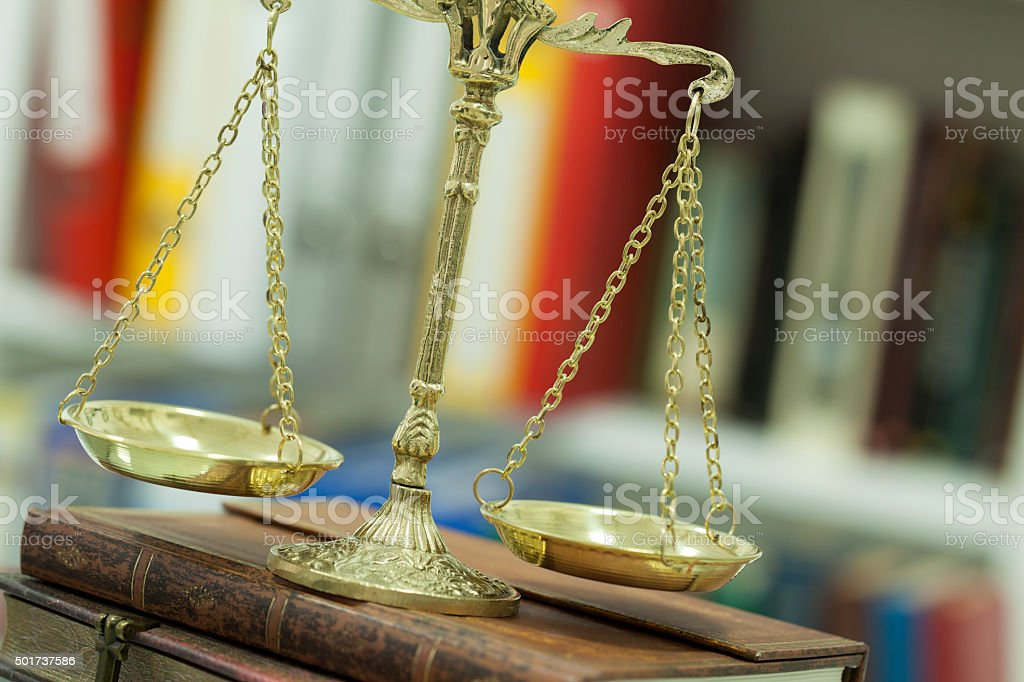 Justice scale with books background stock photo