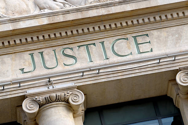 Justice sign Justice sign on a Law Courts building.  New high resolution version shown below: courtroom stock pictures, royalty-free photos & images