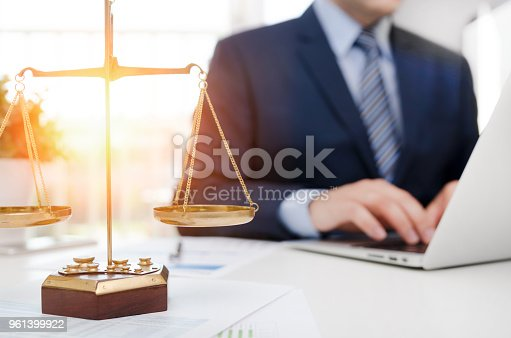 istock Justice symbol weight scales on table 961399922
