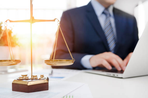 Justice symbol weight scales on table stock photo