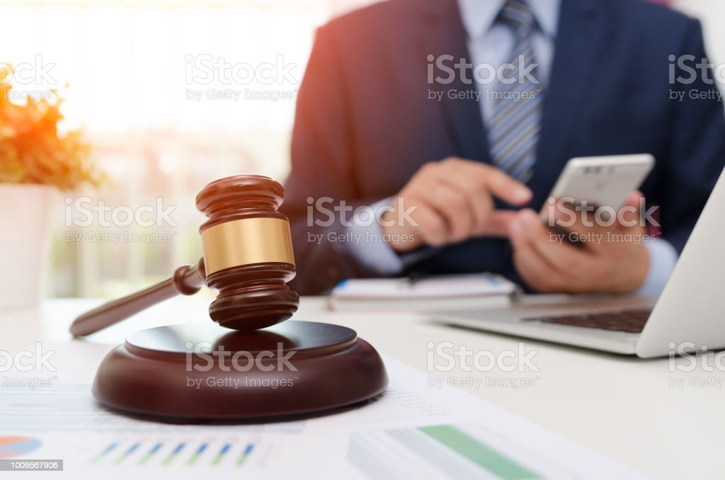 Justice symbol wooden gavel on table. Attorney working in office stock photo