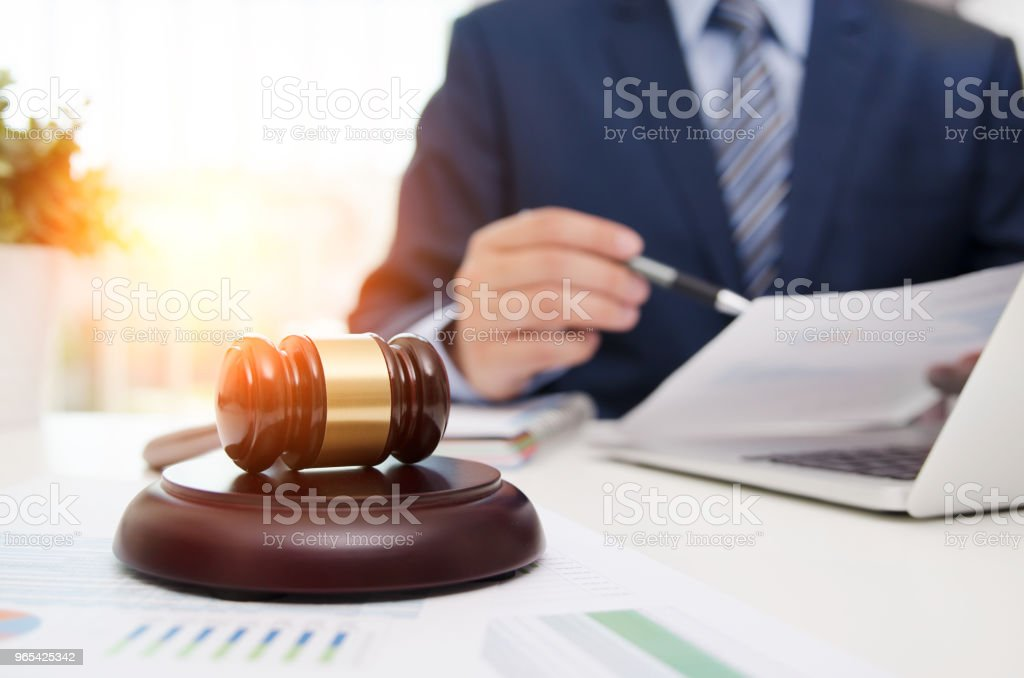 Justice symbol wooden gavel on table. Attorney working in office royalty-free stock photo