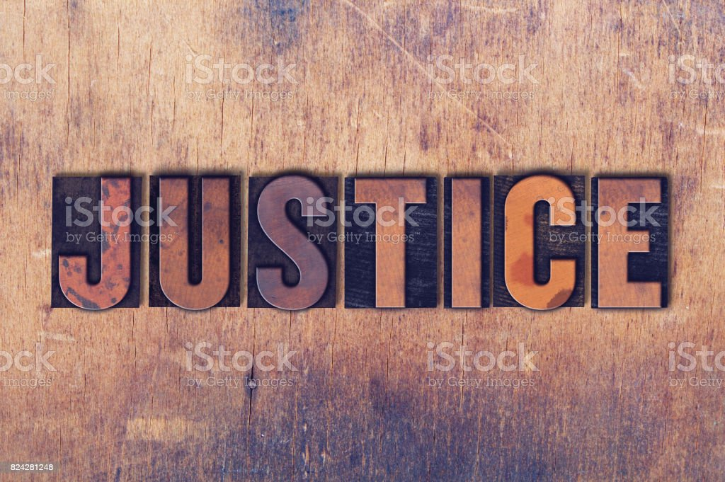 Justice Theme Letterpress Word on Wood Background stock photo