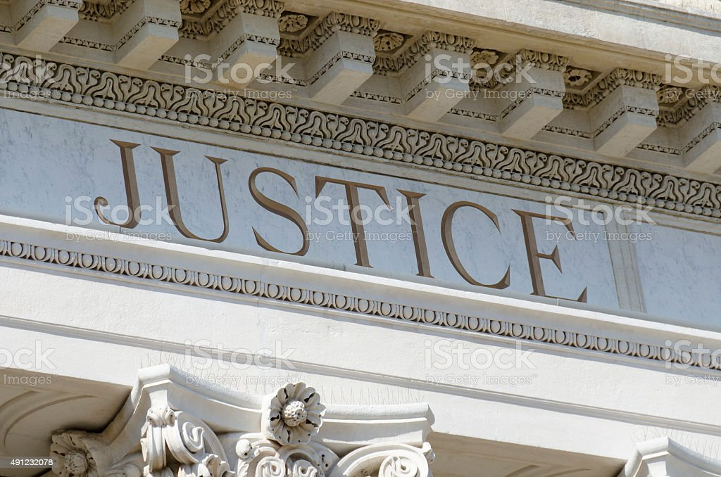 justice word engraved stock photo