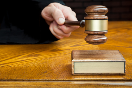 Justice's Hand Pounds Gavel to Block With Blank Plaque