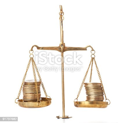 Scales of justify weighting stack of coins. Isolated in white.