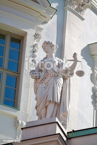 Justitia statue at old town hall Potsdam from 18th century, made in baroque style, town hall was made by architect Peter de Gayette