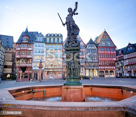 Fountain of Justice (Justitia) on the Römerberg in Frankfurt Am Main, Germany. Composite photo