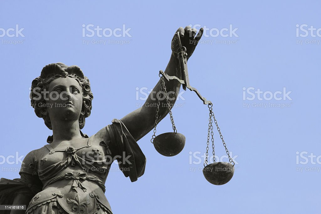 justitia with blue sky stock photo