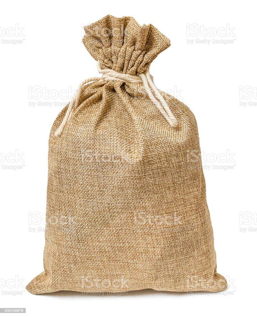 Jute bag full of money isolated on white background. stock photo